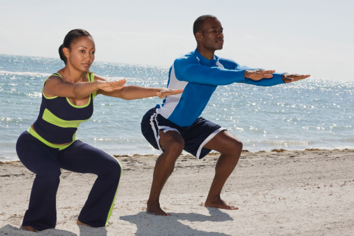 Multi-ethnic couple practicing yoga