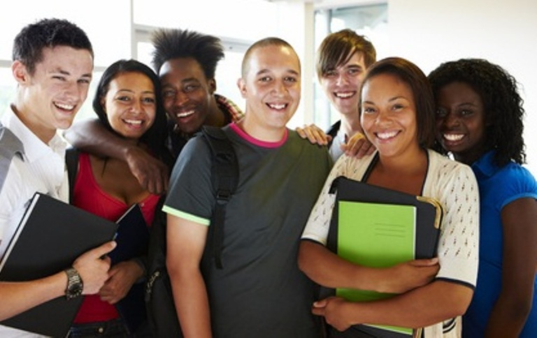 group of multiracial college students smiling