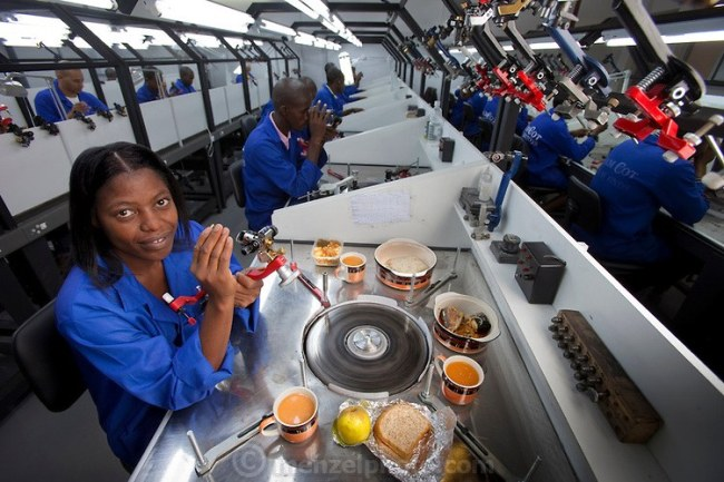 """Mestilde Shigwedha, a diamond polisher for NamCot Diamonds in Windhoek, Namibia with her day's worth of food. (From the book What I Eat: Around the World in 80 Diets.) The caloric value of her day's worth of food on a day in March was 2000 kcals. She is 28 years of age; 5 feet, 1 inch tall; and 120 pounds. Diamonds are one of Namibia's major exports, and while conflict diamonds grab the headlines, the fact is that the industry does provide a fairly decent living for many. """"Mesti,"""" as she is called, grew up in the north of Namibia near the Angola border in a mud and stick house that she helped cement with dung. She now rents a room in a house in Windhoek and supports family members and herself on her small income from Namcot. MODEL RELEASED."""