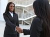 A pretty african american business woman shaking hands; Shutterstock ID 60254809; PO: The Huffington Post; Job: The Huffington Post; Client: The Huffington Post; Other: The Huffington Post