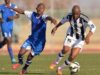 Keaketswe Moloi of Mochudi Center Chiefs and Temo Keorileng of BR Highlanders  during the beMobile Premiership match at Molepolole Sports Complex in Molepolole on 8 August 2015.  ©Monirul Bhuiyan/BackpagePix